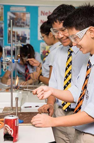 Boys conducting experiment in science laboratory