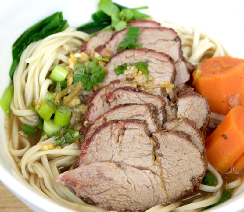 Roast pork fillet in Thai egg Noodle soup