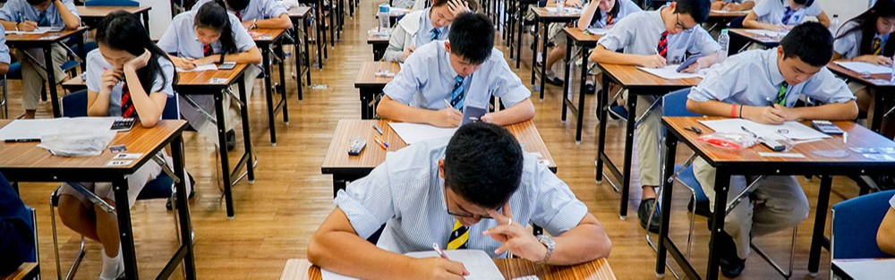 Students taking a test at Harrow Bangkok Exam centre